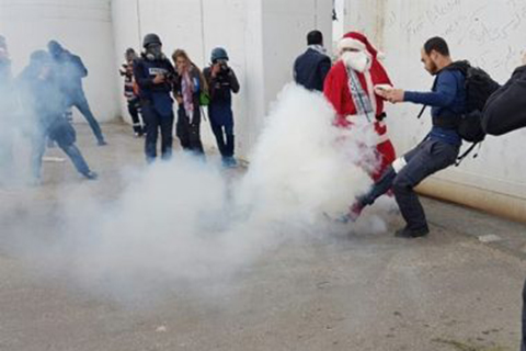 Israeli Forces Violently Subdue Holiday Santa Claus March