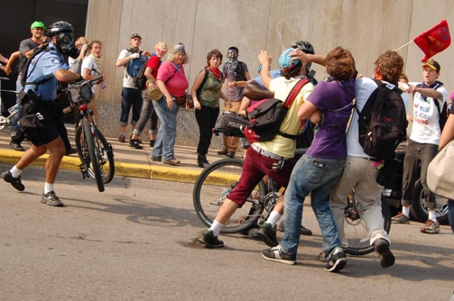 640_bike_cop_attacks_protester-ps.jpg