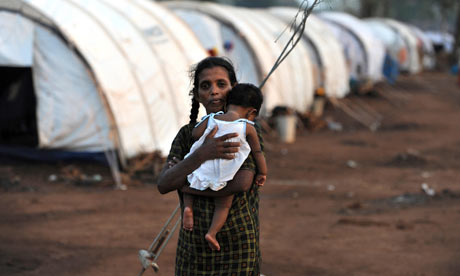 a_displaced_tamil_woman_holds_her_baby_at_a_refugee_camp_in_northern_sri_lanka.jpg