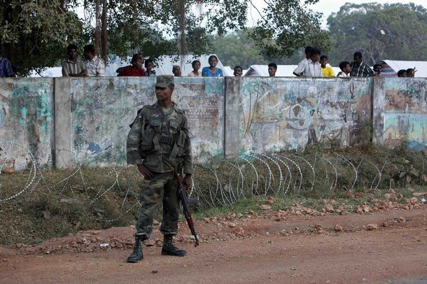 a_soldier_guards_the_wall_where_tamil_people.jpg