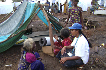a_unhcr_staff_member_talks_to_displaced_people_in_northern_sri_lanka.jpg