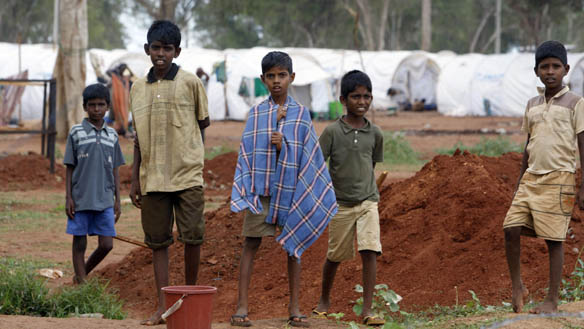 children_stand_in_front_of_razor_wire_at_the_manik_farm_displaced_persons_camp_in_vavuniya_in_sri_lanka.jpg