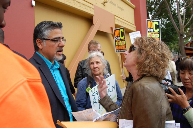 640_avalos_explains_why_he_is_inside_to_retirees_picketing.jpg