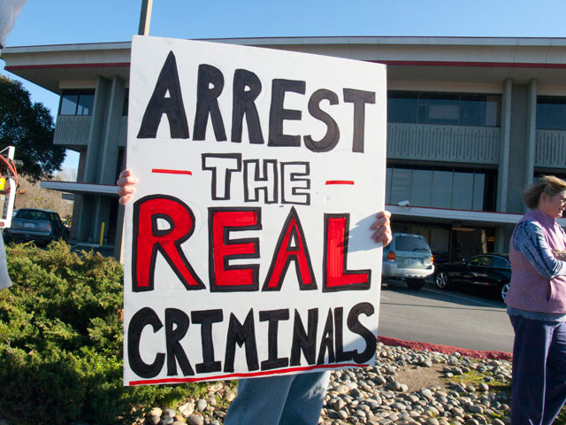 arrest-the-real-criminals_2-15-12.jpg
