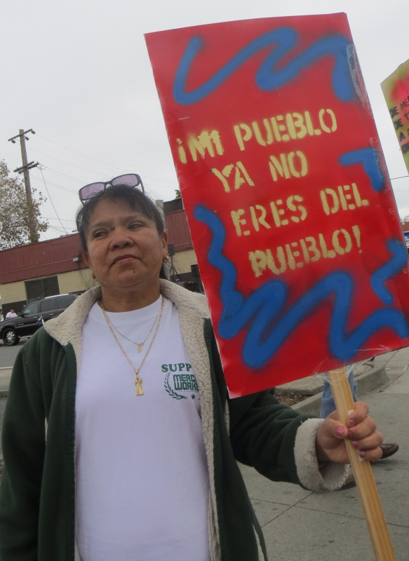 800_silvia_ruiz__an_ex-mi_pueblo_employee_hold_a_sign_during_the_picket.jpg