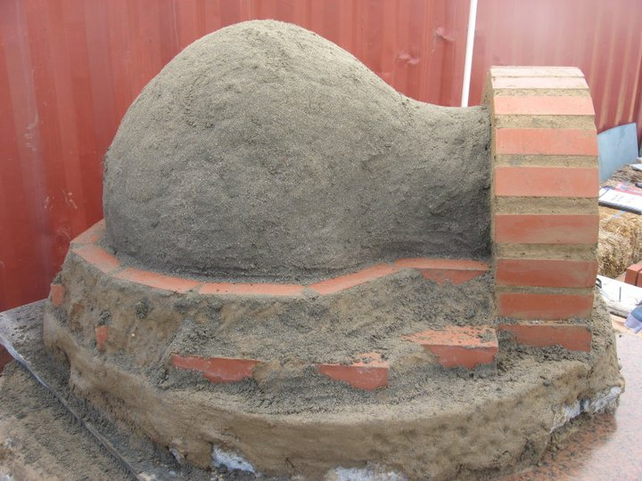 earth_oven_building_at_farm.jpg