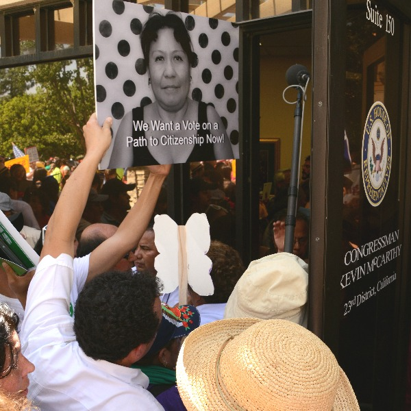 Immigrant rights activists entering the office of Congressman Kevin McCarthy in Bakersfield on August 14, 2013 to urge a vote on a path to citizenship.