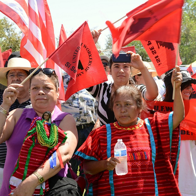 Farmworkers, members of the UFW, rallying for a pathway to citizenship at Yokuts Park.