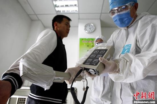 japan_fukushima_resident_tested_for_radiation.jpg