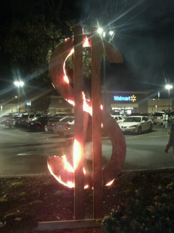 800_sanleandro2013_blackfriday_dollar-sign-on-fire-walmart.jpg