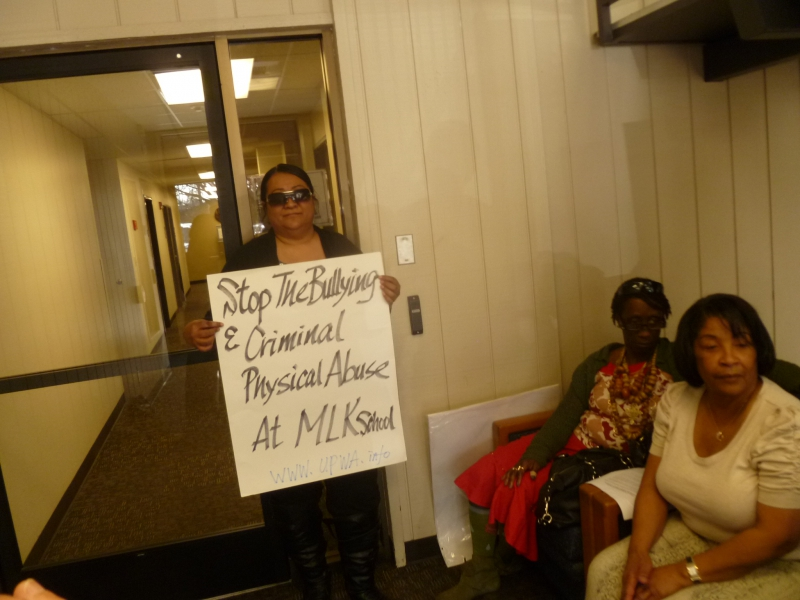 800_ctc_nancy_with_placard_in_lobby_1.jpg
