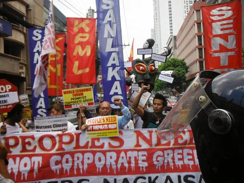 2014-philippines-protest-wef-corporate-greed.jpg