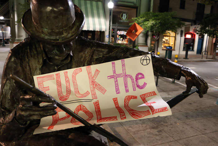 tom-scribner-statue-pacific-avenue-fuck-the-police-santa-cruz.jpg