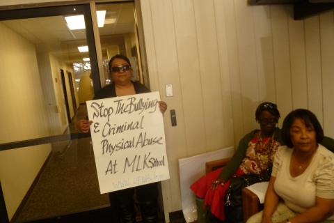 480_ctc_nancy_with_placard_in_lobby.jpg