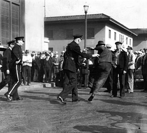 ilwu_gen_strike_cops_pushing_pickets.jpg