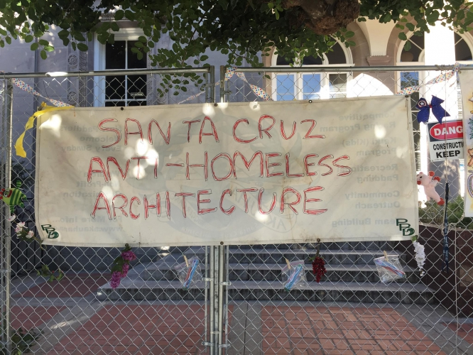 sm_anti-homeless-architecture-fence-decorating-party-santa-cruz-post-office_1.jpg