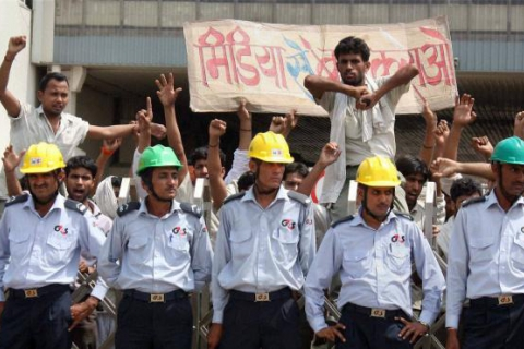 480_india_maruti_suzuki_workers_in_plant_with_guards.jpg