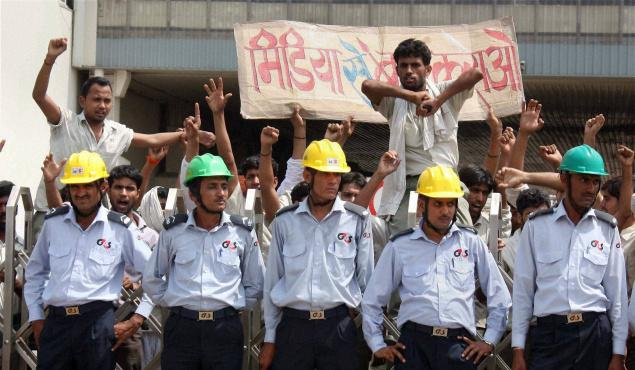 india_maruti_suzuki_workers_in_plant_with_guards.jpg