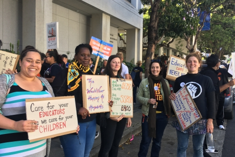 480_uesf_teeachers_with_signs5-9-17.jpg