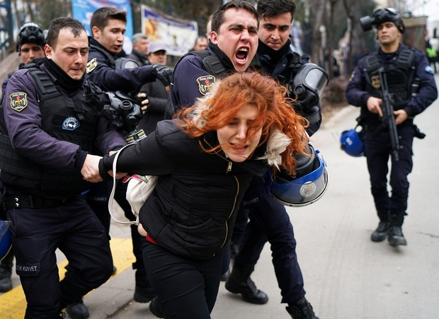 turkish_protester_arrested_by_police_outside_of_ankara_university__reuters_.jpg