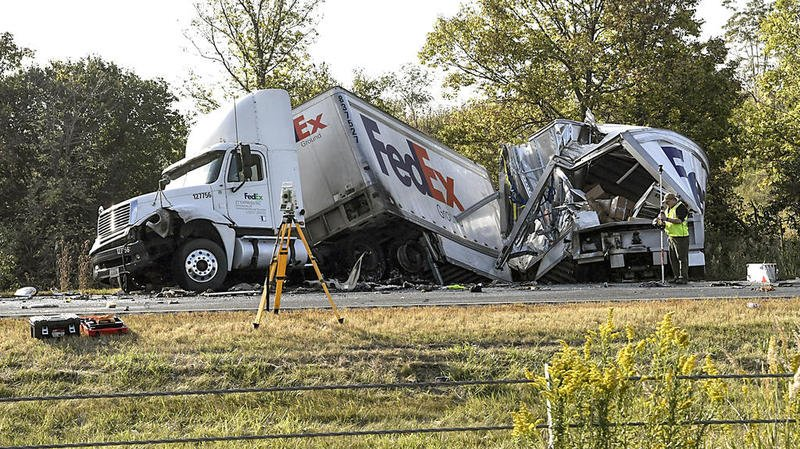 fedex_truck_wrecks_off_road_deaths.jpeg
