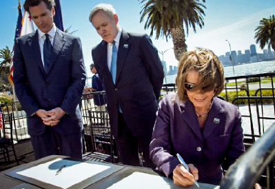 pelosi_signing_over_treasure_nancy_pelosi__navy_secretary_mabus_and_mayor_newsom_signing_the_transfer_of_treasure_island_to_san_francisco_in_august_2010_island.png