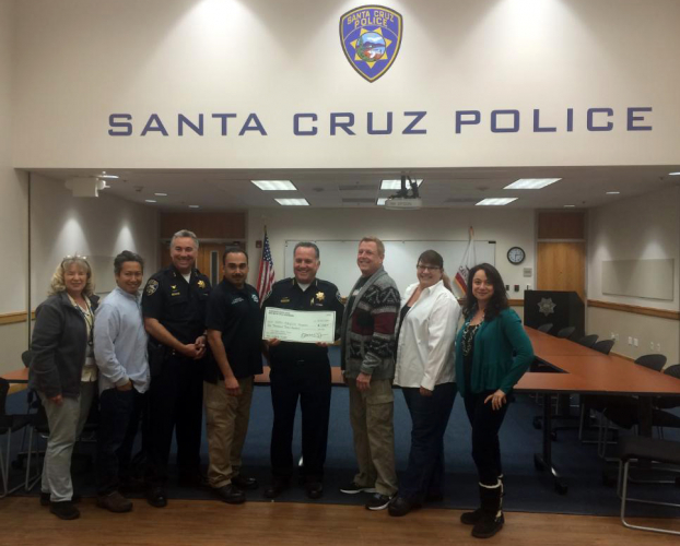 sm_take_back_santa_cruz_police-samantha-olden-dexter-cube-donation.jpg