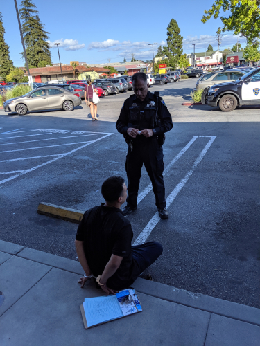 sm_santa-cruz-united-signature-gatherer-handcuffed-detained-santa-cruz-police-whole-foods-market-racist.jpg