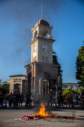 sm_anti_fourth_of_july_block_part_march_santa_cruz_4th_2020_-_13_town_clock_american_flag_burning.jpg
