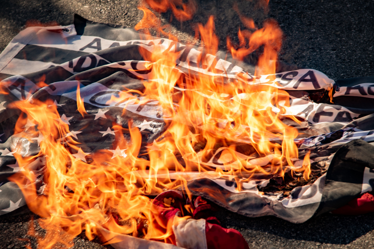 sm_anti_fourth_of_july_block_part_march_santa_cruz_4th_2020_-_6_andy_mills_nader_oweis_burning_police_flag.jpg
