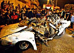 Car of Hamas leader, al-Rantissi, blown up by Israeli assassins.
