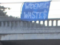 Banner Hung to Protest Highway 1 Wideing in Santa Cruz