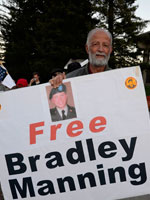 "Demonstrators ask, ""What about the War Crimes?"" at Free Bradley Manning Protest"