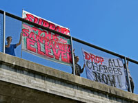 "Banners on Highway One: ""Support The Santa Cruz Eleven"" and ""Drop All Charges Now!"""