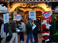 Labor Gives Management Bag of Coal at La Playa Carmel Holiday Workers Rally