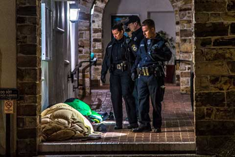 Santa Cruz Police Eject Homeless Individuals Sleeping at City Hall During Rainy Weather