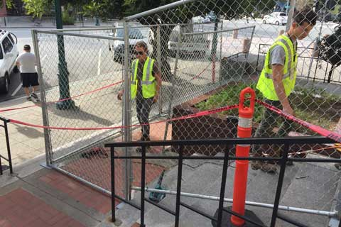 Community Members Decorate Anti-Homeless Fence at Santa Cruz Post Office