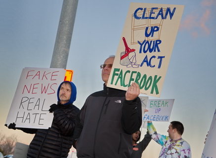 "Protesters Hijack Giant ""Like"" Sign at Facebook Headquarters"